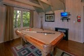 Rusti Cabin with a loft that features Pool Table