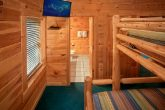 Cabin with queen bunk beds and TV