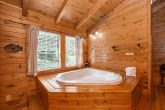 One Bedroom Cabin that Features a Hot Tub