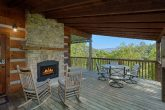 Cabin with outdoor Fireplace and wooded View