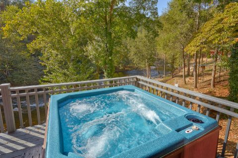 Hot Tub overlooking the River at 7 bedroom cabin - River Mist Lodge