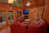 Spacious living room in 3 bedroom river cabin