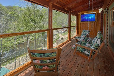 Deck Over Looking the River 2 Bedroom Cabin - River Pleasures