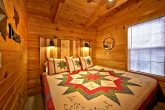 Cabin with King bedroom and log headboard
