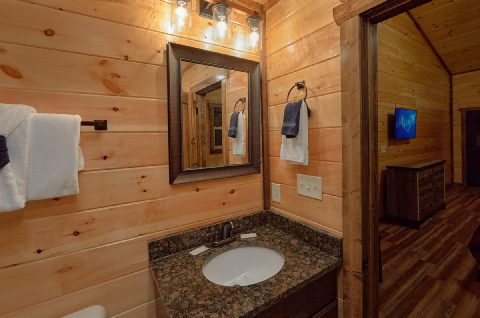 King bedroom with bath in 3 bedroom cabin rental - Smoky Bear Lodge