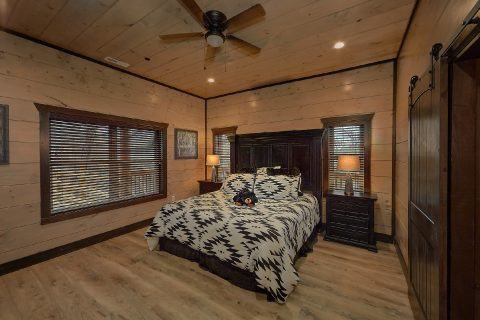 Main Level Master Bedroom in 15 bedroom cabin - Smoky Mountain Masterpiece
