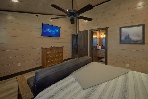 Private Bath, Futon and TV in King cabin bedroom - Smoky Mountain Masterpiece