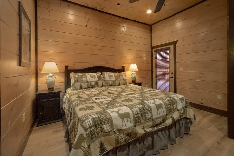 Rental cabin master bedroom with private deck - Smoky Mountain Masterpiece