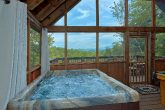 Cabin with hot tub on screened in porch