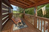 2 bedroom cabin with porch swing and fire pit