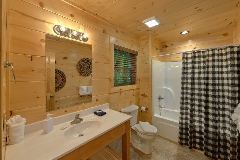 Master bedroom with private bath in cabin rental - Song of the South