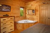 Cabin with Jacuzzi and Fireplace in Bedroom