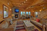 Living room with fireplace in 9 bedroom cabin