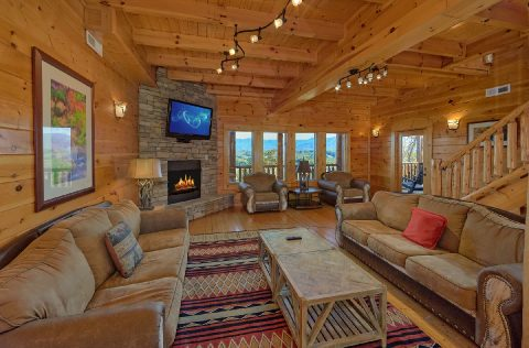 Living room with fireplace in 9 bedroom cabin - Summit View Lodge
