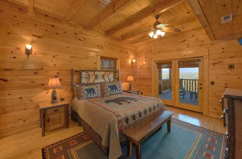 King bedroom with private deck access in cabin - Summit View Lodge