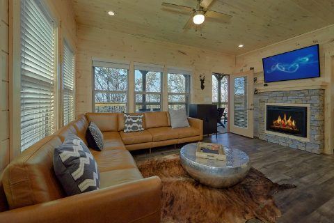 Spacious Living Room with Cable TV and Fireplace - The Bear and Buck