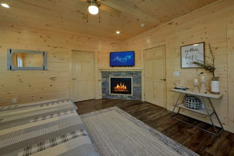 King Bedroom with Flatscreen TV and Fireplace - The Bear and Buck