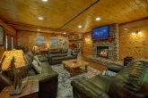 Living room with fireplace in 11 bedroom cabin