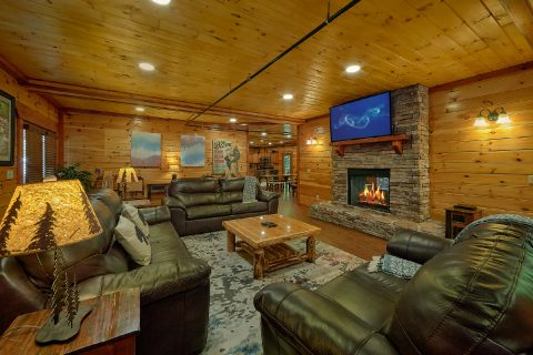 Living room with fireplace in 11 bedroom cabin - The Big Lebowski