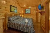 Master Bedroom with King bed and bath in cabin