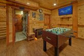 Luxury cabin with arcade games and foosball game