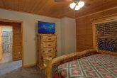 King bedroom with TV in 6 bedroom cabin