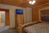 King bedroom with TV in 6 bedroom cabin