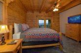 Queen bedroom with balcony in cabin rental