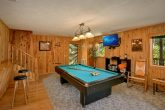 Game Room with Pool Table, Couch & Bar Stools