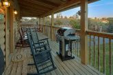 2 bedroom cabin with grill and rocking chairs