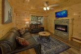 Living room with fireplace in 4 bedroom cabin