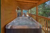4 bedroom cabin with hot tub and gas grill